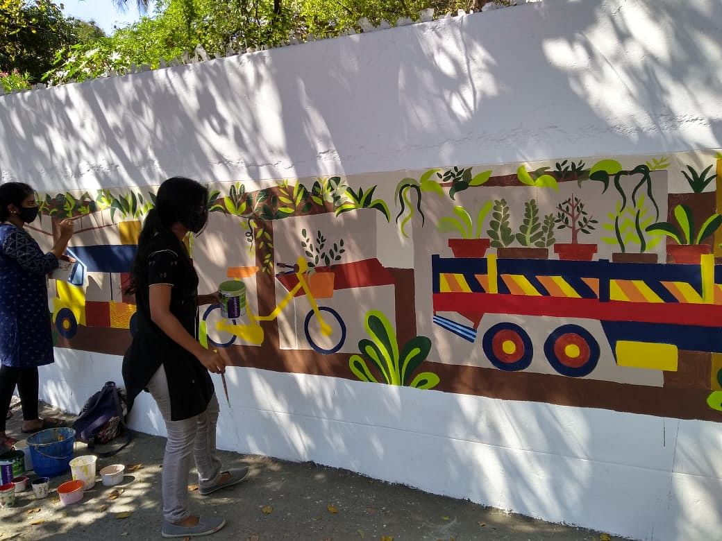 "Stella Maris College students paint the campus walls for a ""Green Future"""