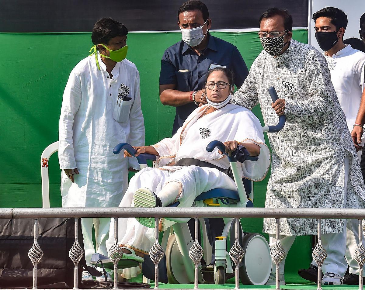 Kolkata: TMC leader Aroop Biswas pulls the wheelchair of WB CM and TMC Supremo Mamata Banerjee during Nandigram Diwasrally at Hazra crossing from Gandhi Statue, in Kolkata, Sunday, March 14, 2021.