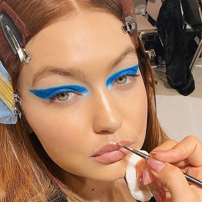 Gigi Hadid returns to runway 5 months after giving birth to daughter; flaunts red hair