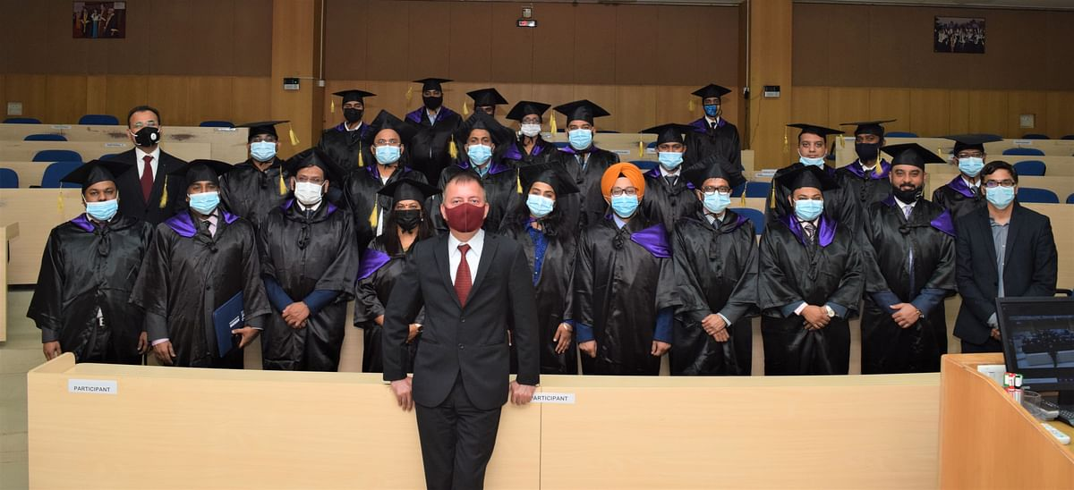 IIM Indore director Prof Himanshu Rai poses for a group photo with the graduating candidates during the valedictory function at IIM Indore on Friday.
