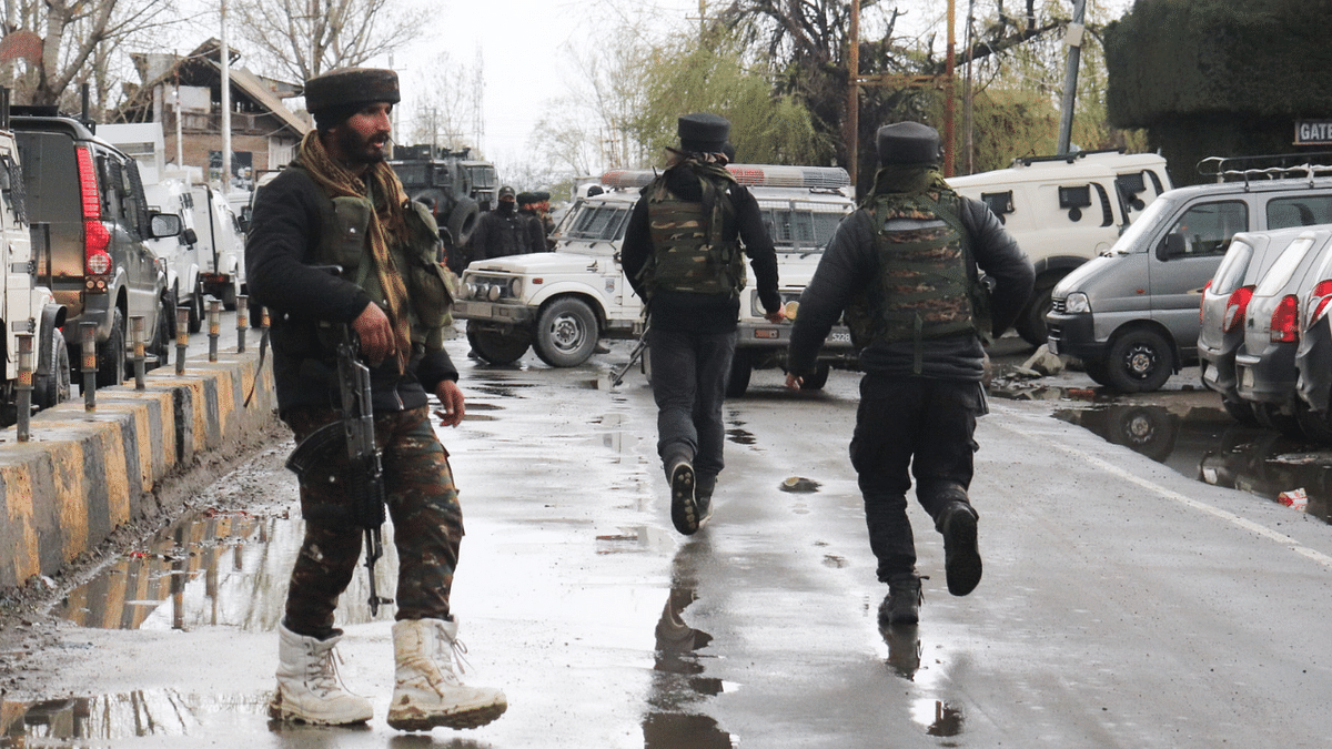 Army men rushing near the spot of the militant attack in the Sopore area of Jammu and Kashmir