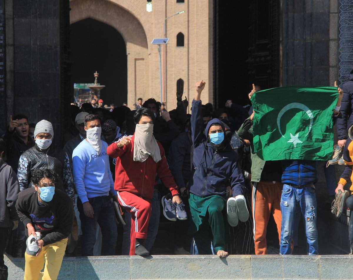 Kashmiri protestors gather as they shout pro freedom slogans during clashes after friday congregational prayers outside the Jamia Masjid in downtown Srinagar on March 5, 2021 to demand the release of Mirwaiz Umar Farooq, Kashmir's Chief cleric who has been under house arrest for 20 months.