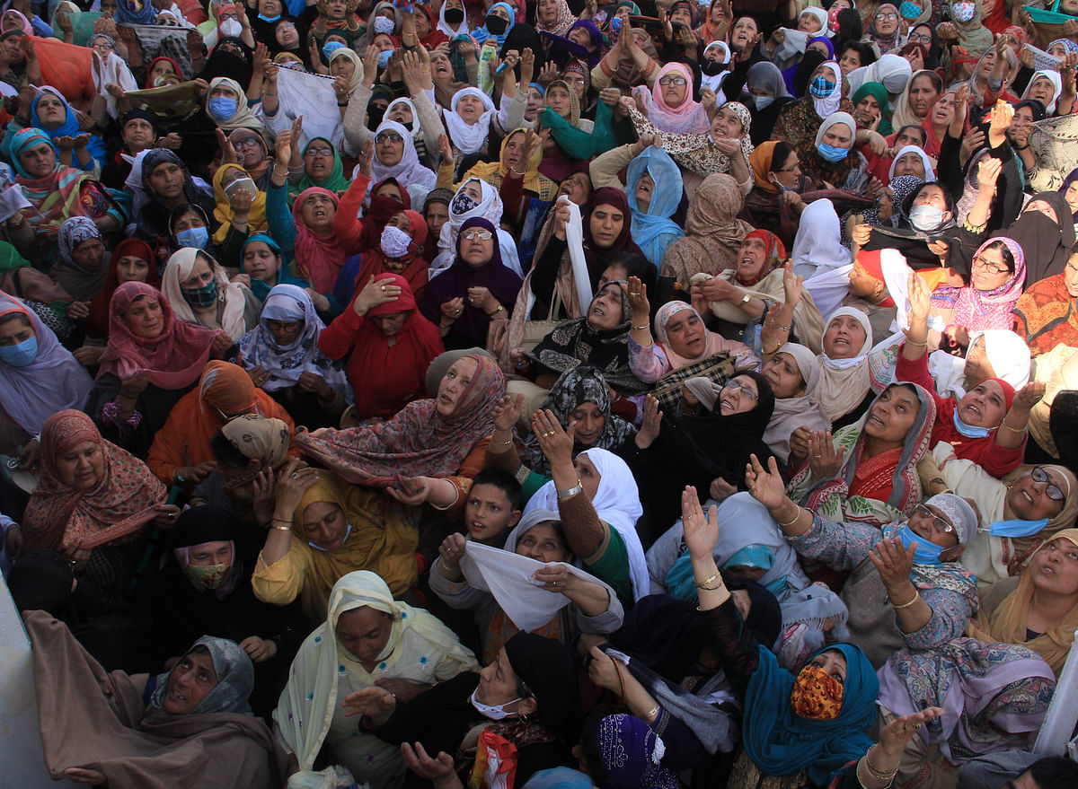 Kashmiri Muslim women react upon seeing a relic believed to be a hair from the beard of Prophet Mohammed, being displayed on Friday following Meeraj-un-Nabi, a festival which marks the ascension of Prophet Mohammed to Heaven, at the Hazratbal shrine in Srinagar.