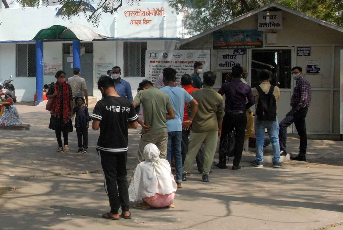 People queue up to get tested for coronavirus in Bhopal on Wednesday.