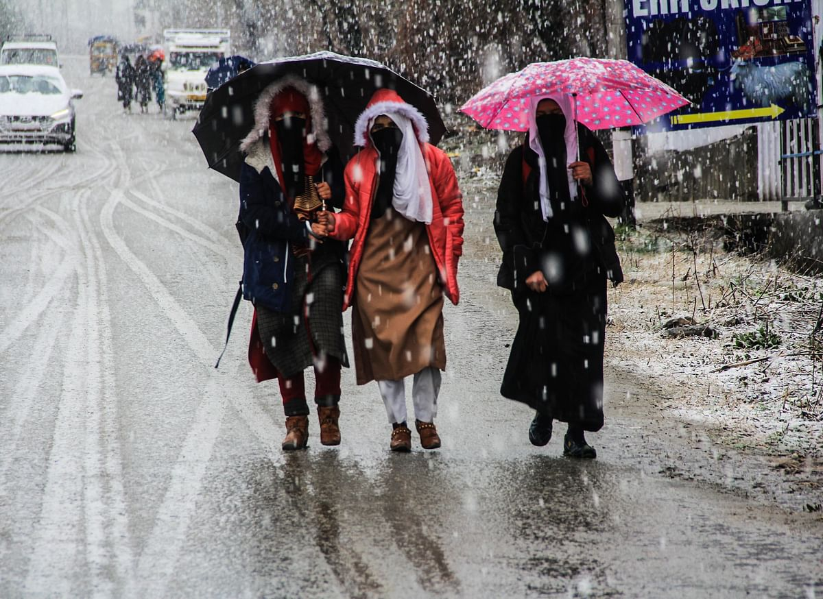 Commuters on the road during fresh snowfall on March 08 2021 in parts of Kashmir.