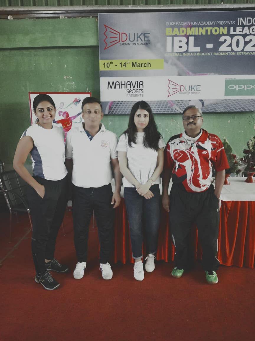 Indore Badminton Association  co-secretary Dharmesh Yashlaha (red shirt) with players