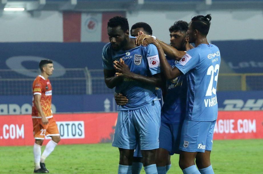 Mumbai players celebrate after the equaliser