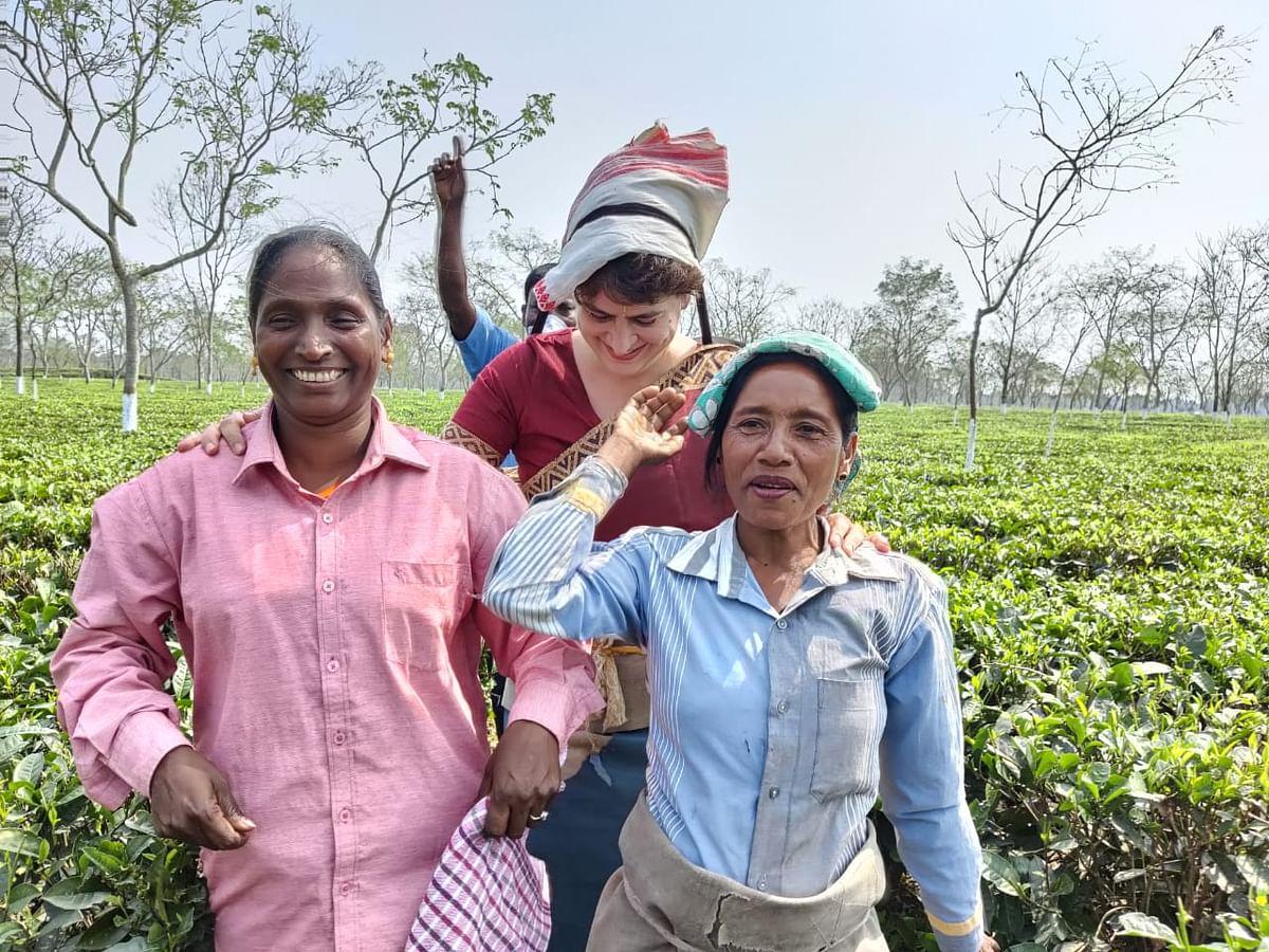 Priyanka Gandhi Vadra sharing a laugh with tea plantation workers at the Sadharu Estate, Biswanath, Assam.