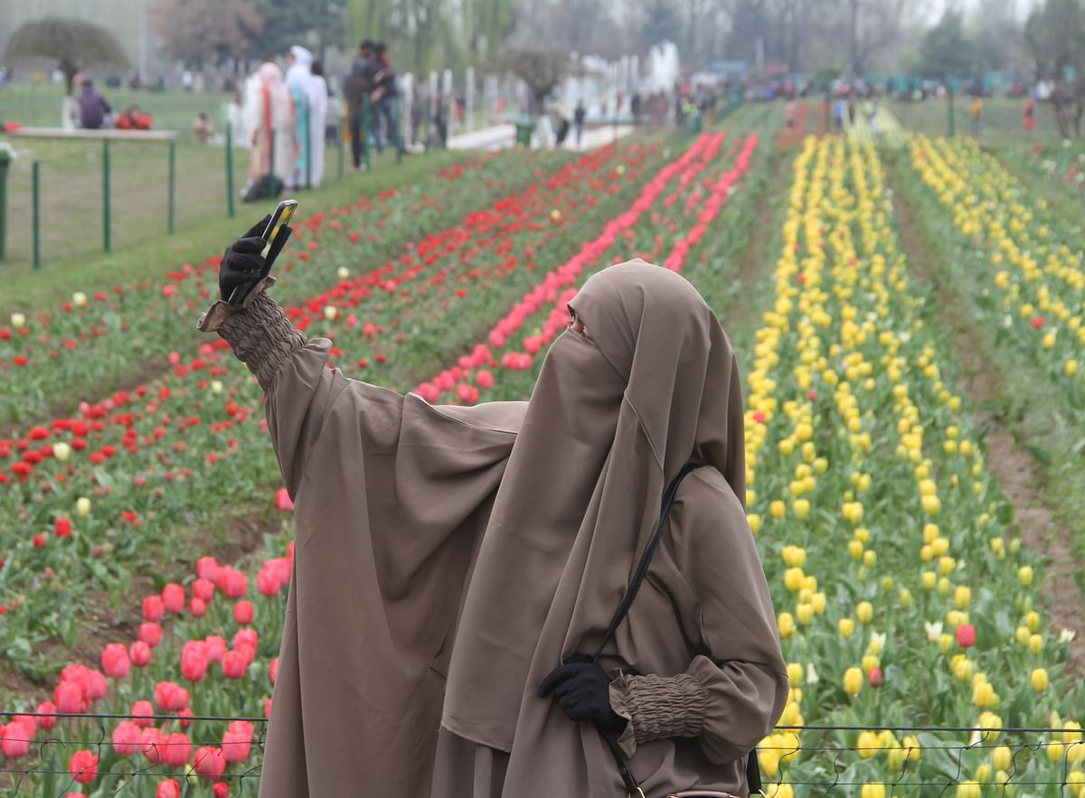 Visitors take selfies on their visit to Indira Gandhi Memorial Tulip Garden, believed to be Asia's largest, in Srinagar on Thursday.