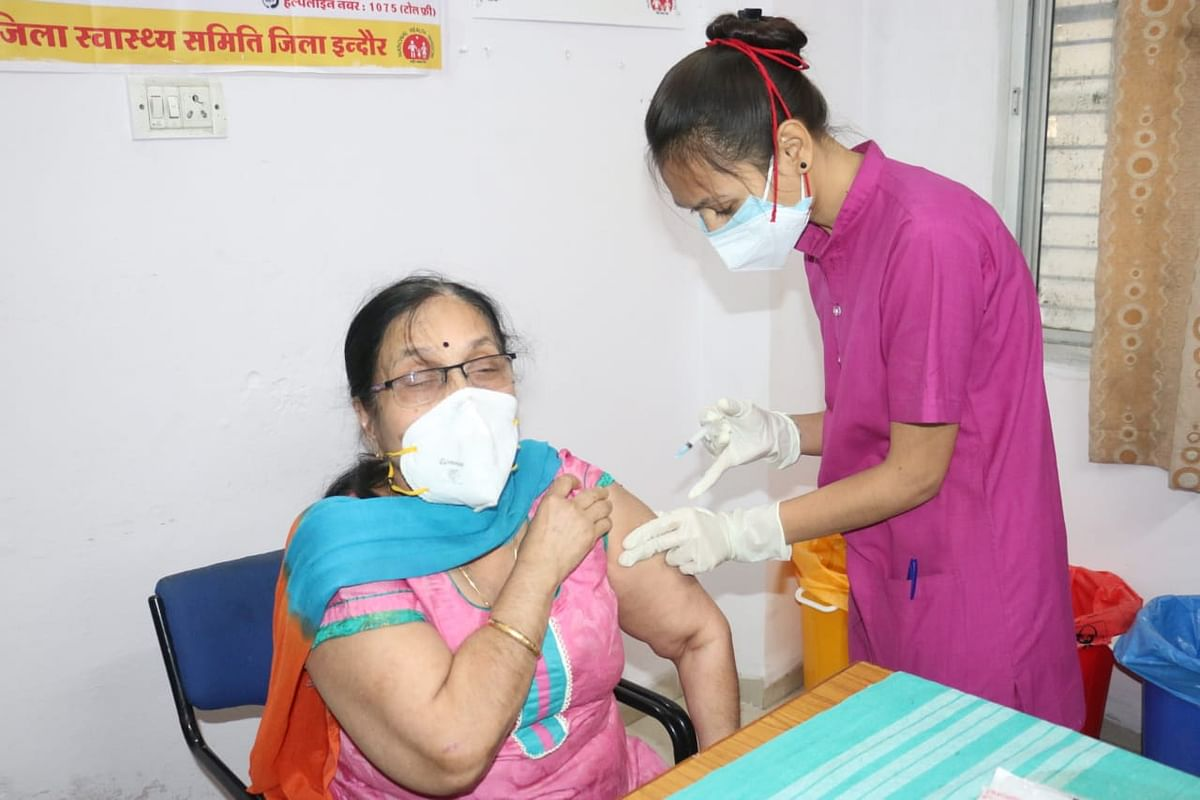 Woman being inoculated at PC Sethi Hospital