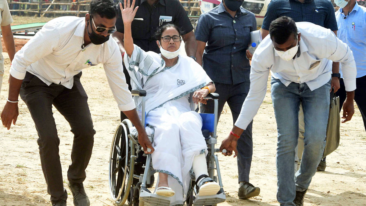 West Bengal, March 18 (ANI): West Bengal Chief Minister Mamata Banerjee on the wheelchair goes to address an election campaign rally ahead of the state assembly election, in West Medinipur on Thursday.
