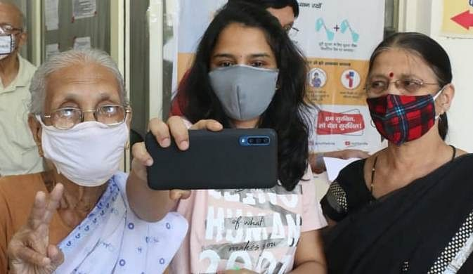 A woman with her mother-in-law and grand mother-in-law arrived at PC Sethi Hospital vaccination centre in Indore on Monday