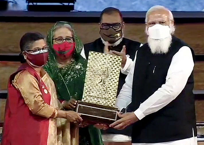 Went to jail while protesting for Bangladesh's liberation, says PM Modi in Dhaka; hands over Gandhi Peace Prize for Sheikh Mujibur Rahman to his daughters