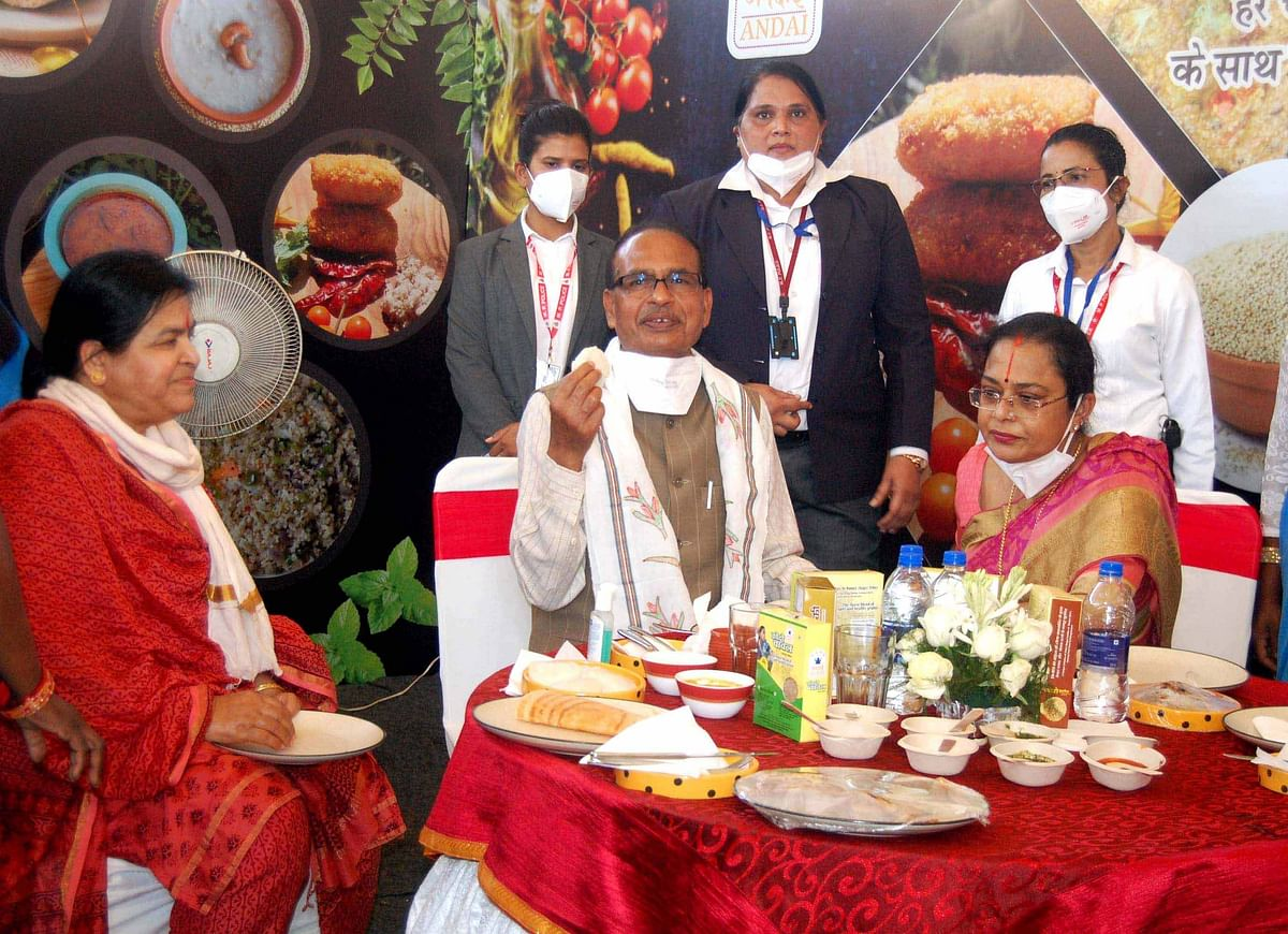 Chief Minister Shivraj Singh Chauhan with wife having lunch at restaurant in Bhopal Hatt International Women's Day on Monday.