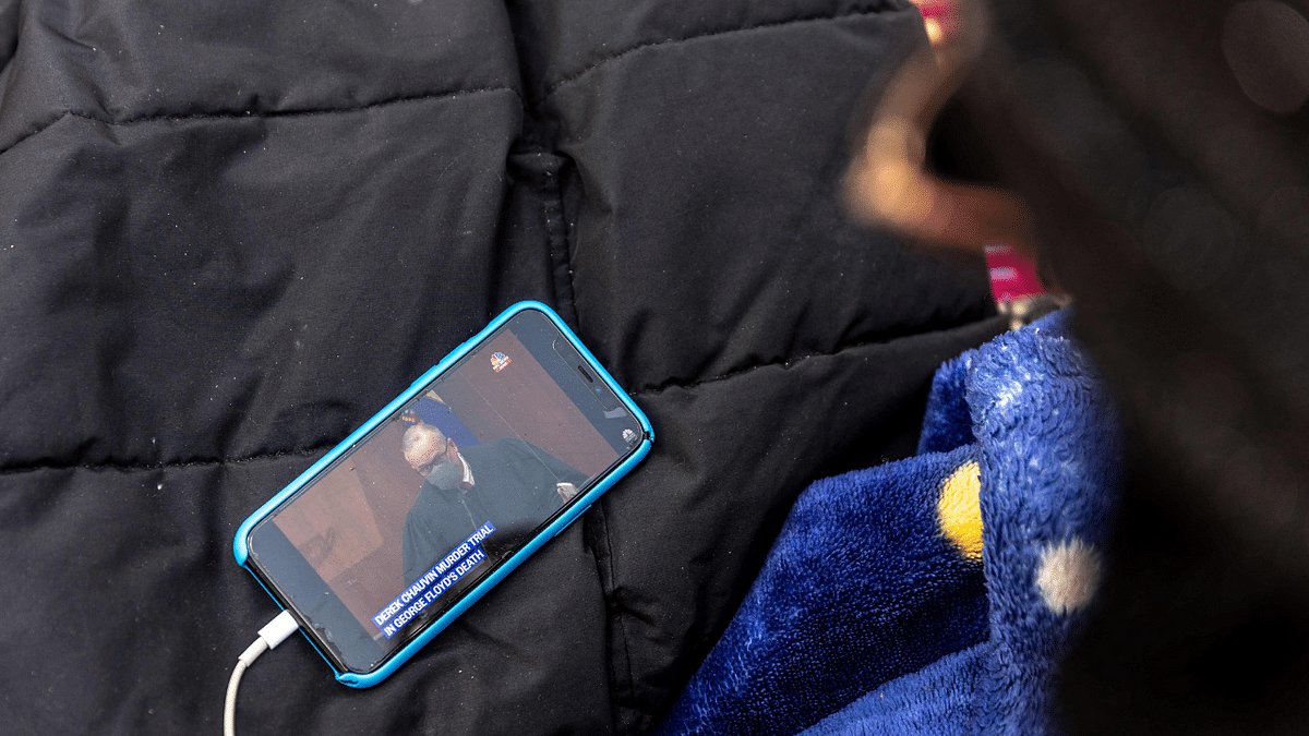 An activist listens to Judge Cahill outside the Hennepin County Government Center during the murder trial of former Minneapolis Police officer Derek Chauvin in Minneapolis, Minnesota on March 30, 2021.
