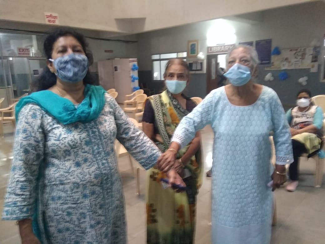 An elderly woman walks into vaccination centre at Aurobindo hospital in Indore on Monday