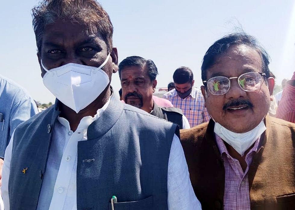 Madhya Pradesh health minister Prabhuram Choudhary (in mask)  at helipad