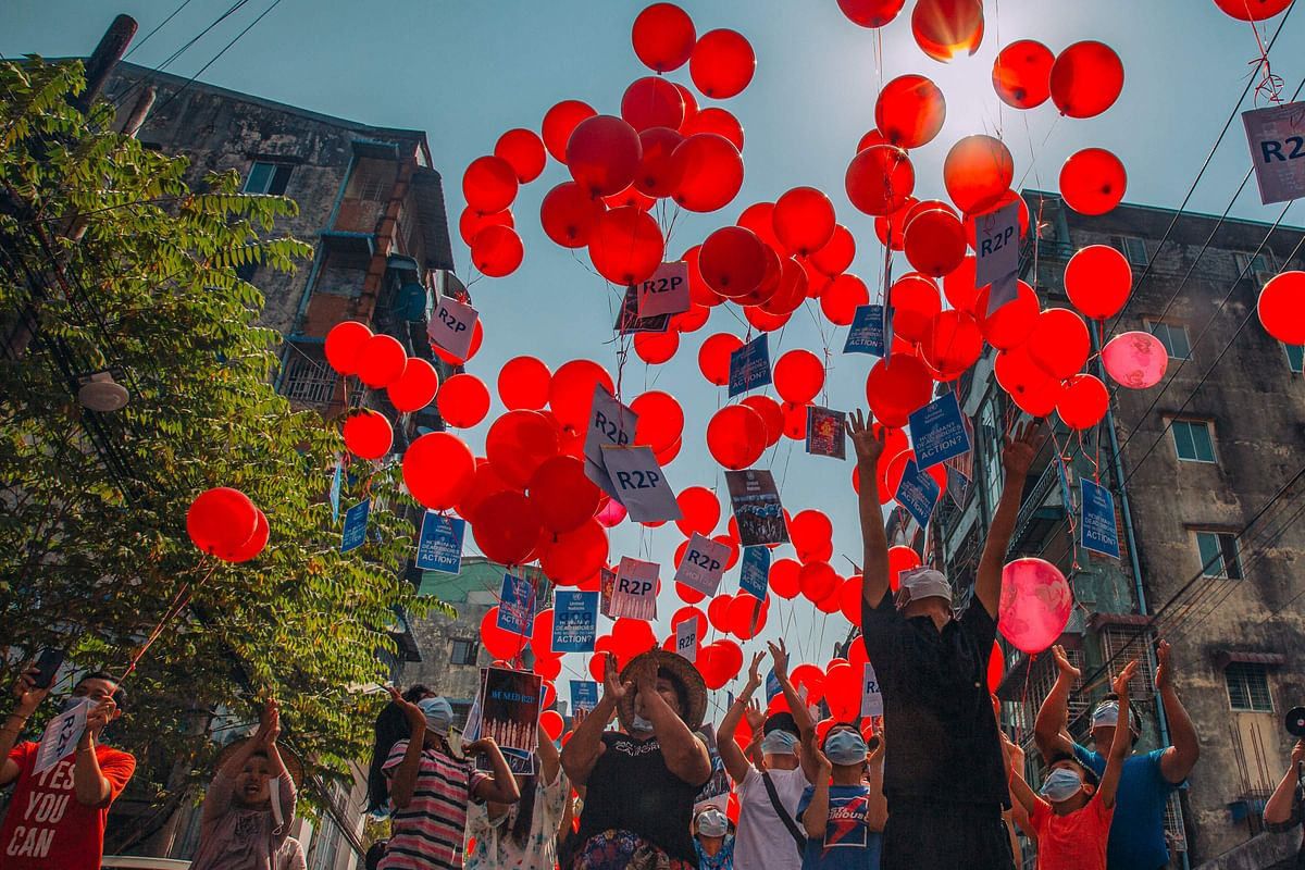"This photo taken and received courtesy of an anonymous source via Facebook on March 22, 2021 show residents setting free balloons with messages relating to ""R2P"", or the ""Responsibility to Protect"" principle that the international community is justified in taking action against a state that is deemed to have failed to protect its population from atrocities, in Yangons Hlaing township, as security forces continue to crackdown on demonstrations by protesters against the military coup."