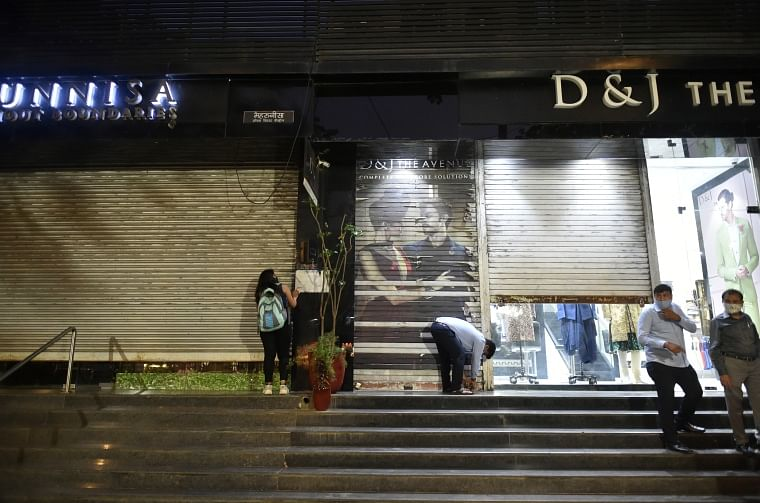 Shop owners were seen shutting their shops amid night curfew imposition