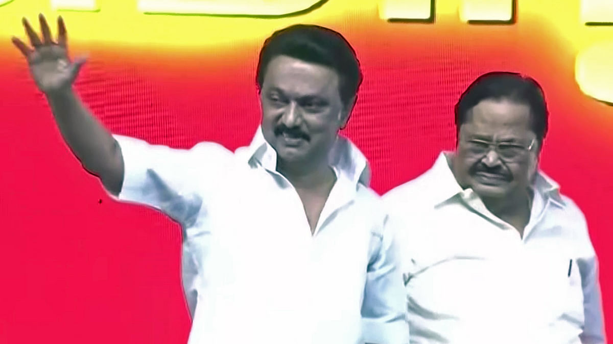 DMK President MK Stalin along with party leader Durai Murugan greets the supporters during a rally