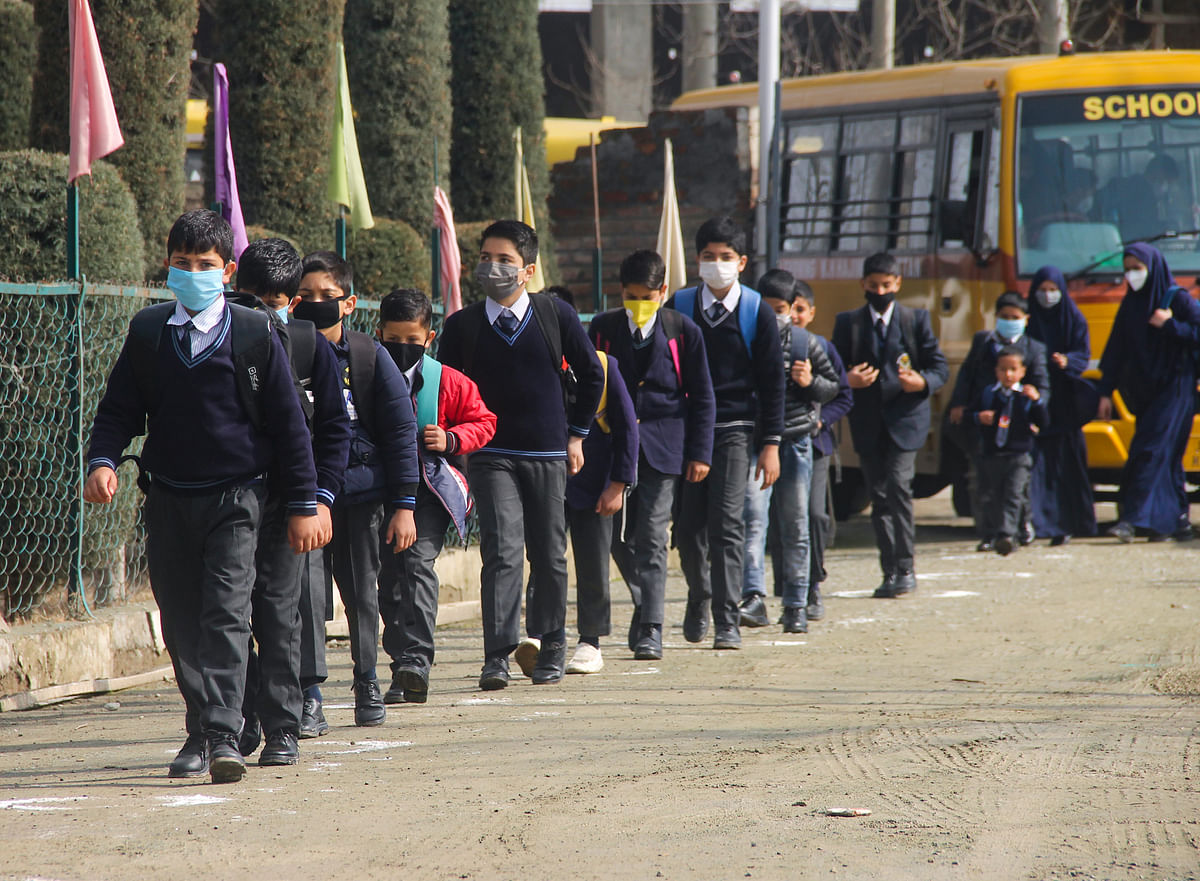 Students of junior wing attending classes on the first day of school as they reopen after almost a year, at  Srinagar, kashmir.