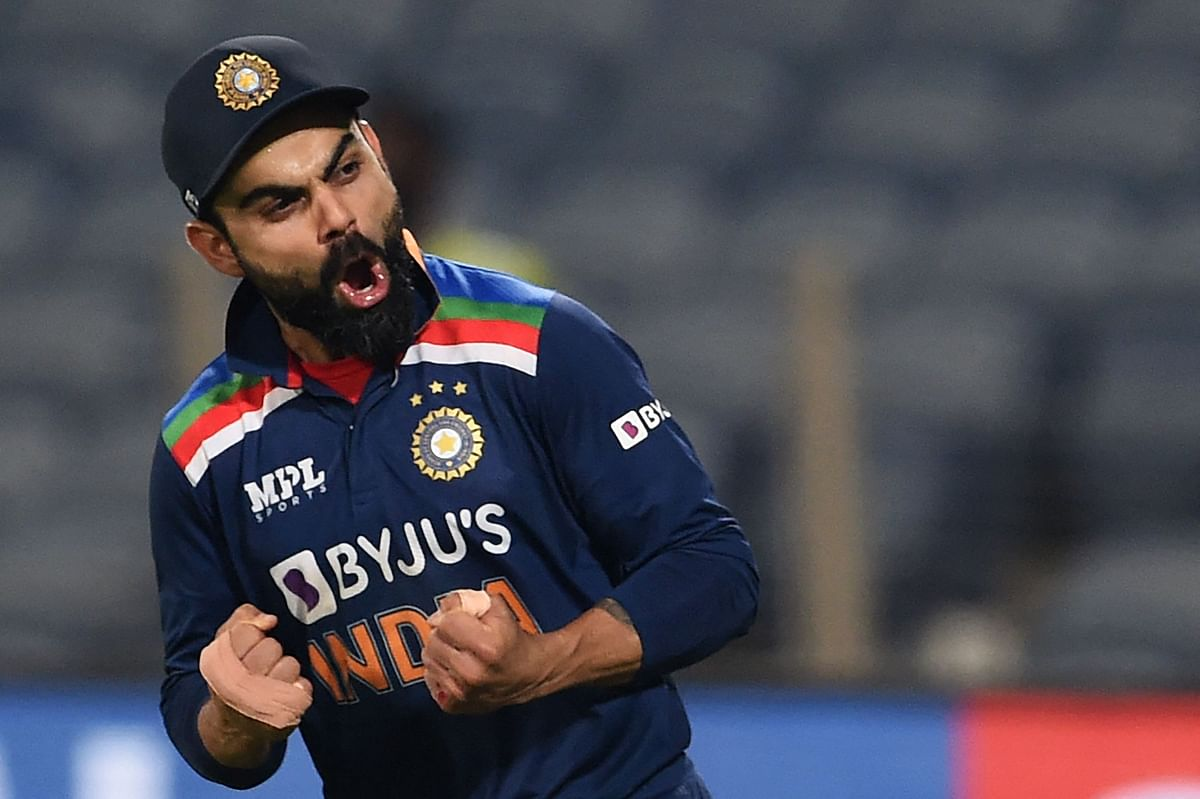 India captain Virat Kohli celebrates the win after the third and final one-day international (ODI) cricket match between India and England at the Maharashtra Cricket Association Stadium in Pune on March 28, 2021.