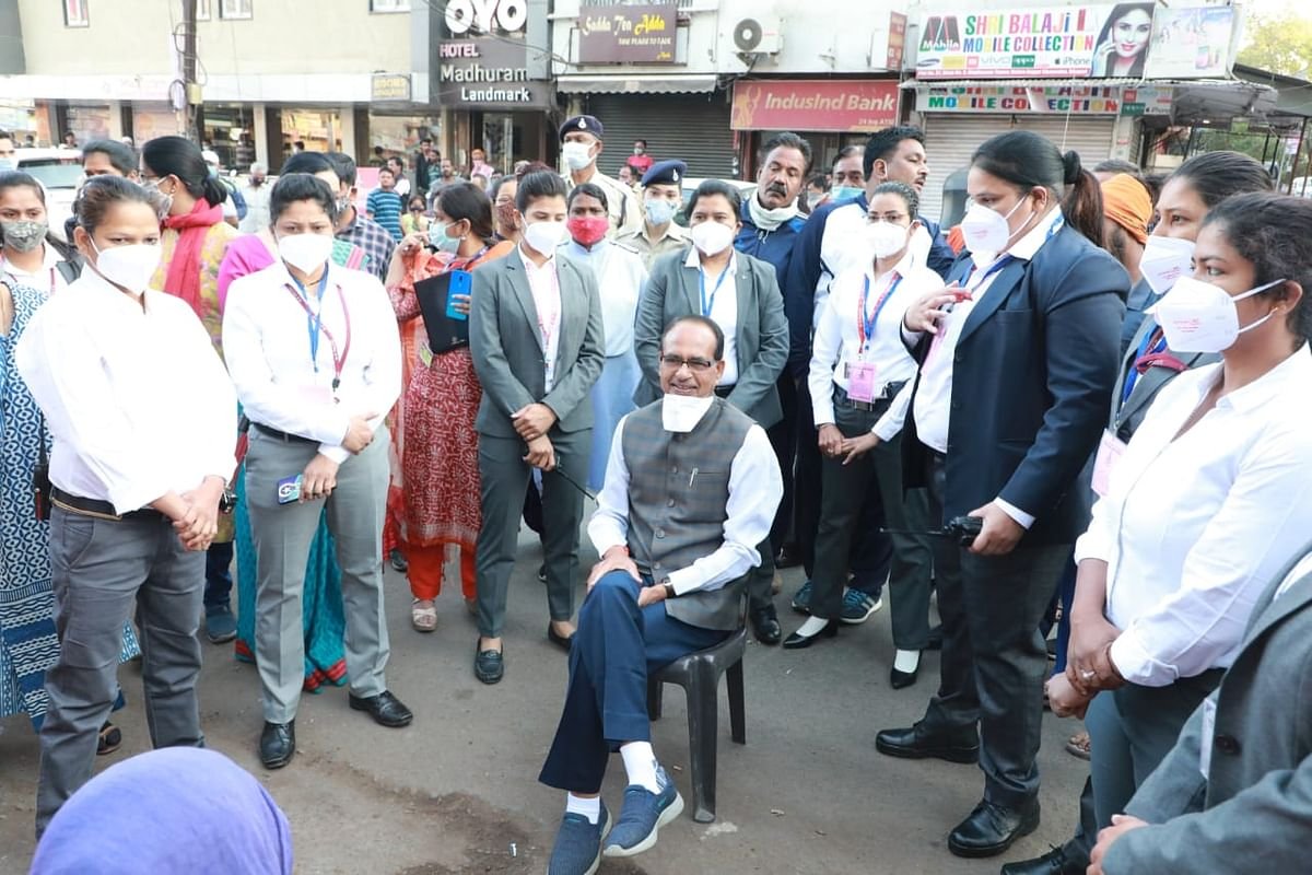 Chief minister Shivraj Singh Chouhan listened to what the sanitary workers had to say near  Nehru Nagar Square on Monday morning