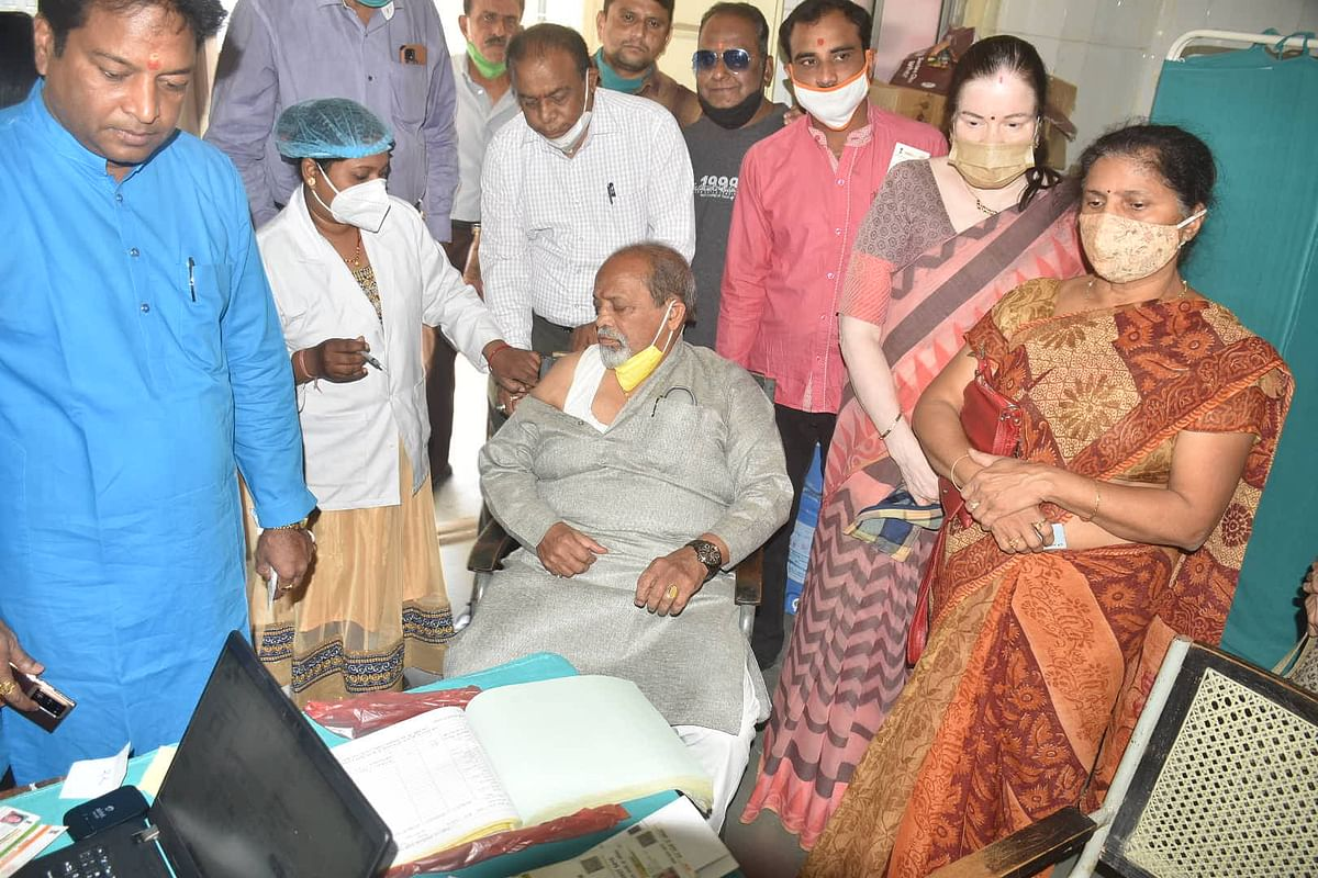 Corona vaccine being administered to senior BJP MLA Paras Jain and his wife at a government hospital, in Ujjain on Saturday