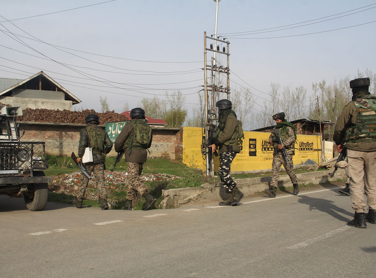 Paramilitary soldiers inspect the spot of militants attack in Lawaypora on the outskirts of Srinagar.