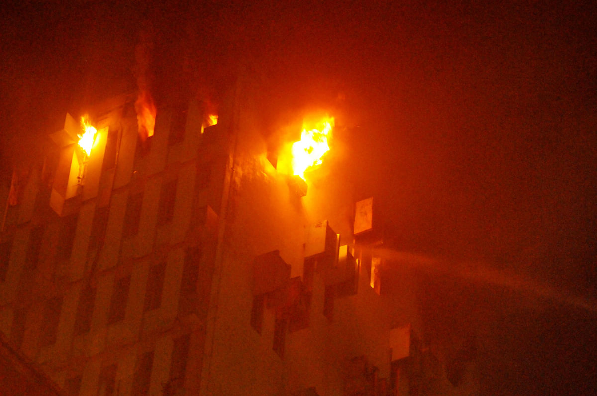 Fire on the 13th floor of a multi-storeyed building in Kolkata, Monday, March 8, 2021