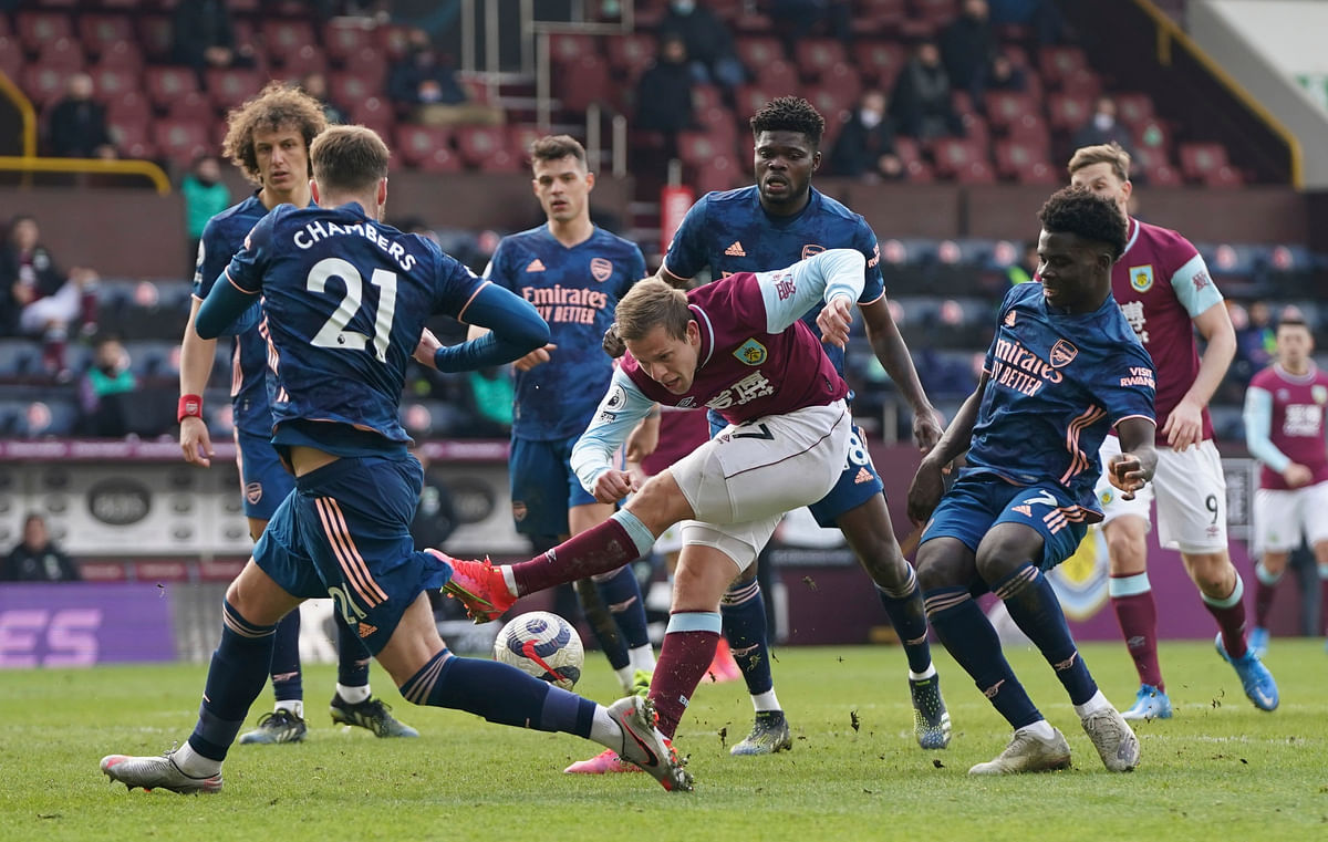 Burnley's Matej Vydra (center) clears the ball during the English Premier League soccer match against Arsenal at Turf Moor stadium in Burnley, on Saturday