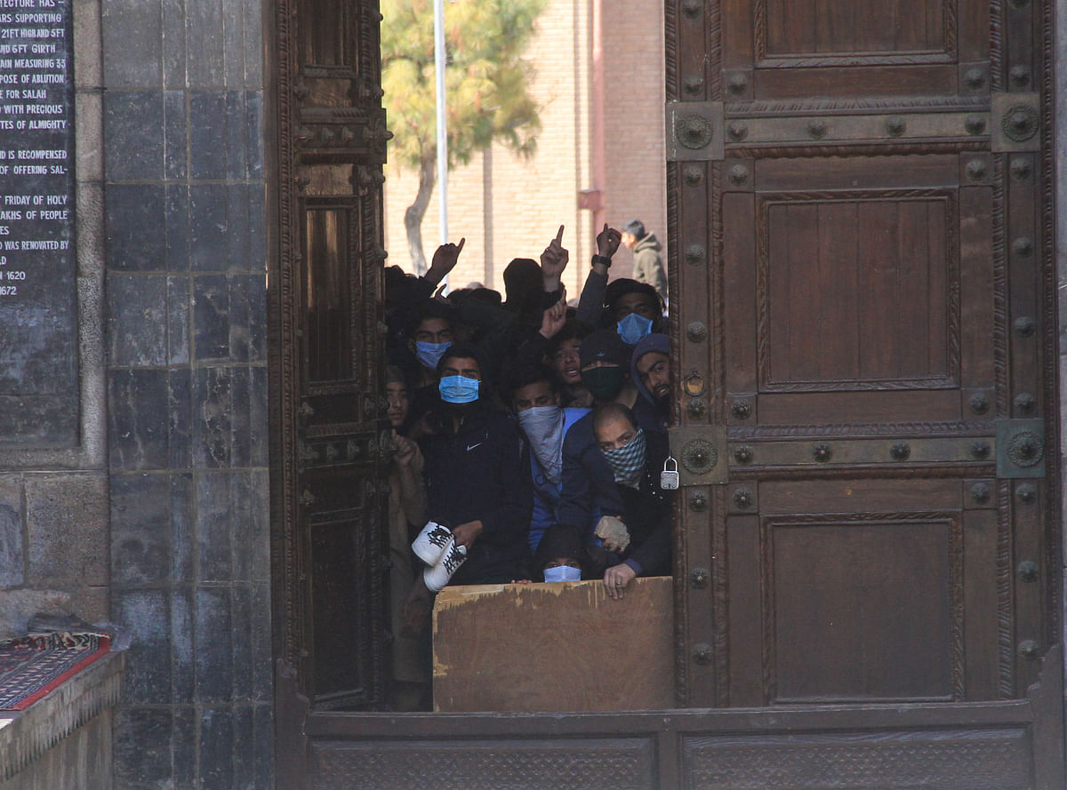 Kashmiri protestors clash with government forces at the Jamia Masjid after Friday prayers, in downtown Srinagar on March 5, 2021 to demand the release of Mirwaiz Umar Farooq, Kashmir's Chief cleric who has been under house arrest for 20 months.