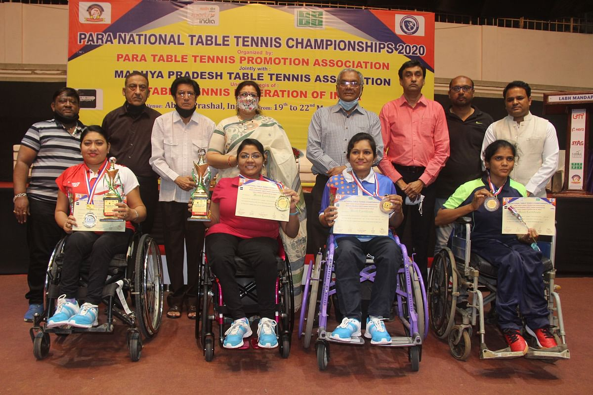 Winners with trophies, certificates