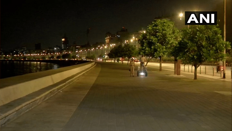 Police officials seen patroling during the curfew at the famous Marine Drive