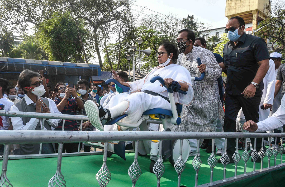 Kolkata: TMC leader Aroop Biswas pulls the wheelchair of WB CM and TMC Supremo Mamata Banerjee during Nandigram Diwasrally at Hazra crossing from Gandhi Statue, in Kolkata, Sunday, March 14, 2021.