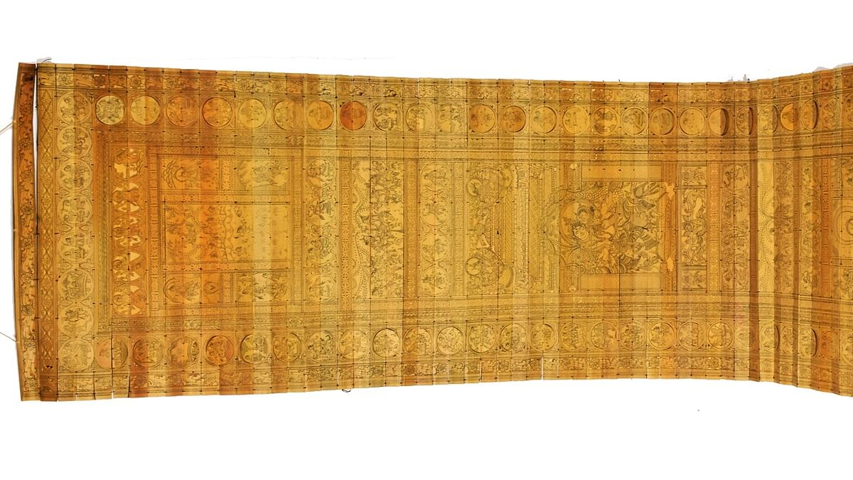 Pattachitra- Stitched palm leaves carved with fine black thread
