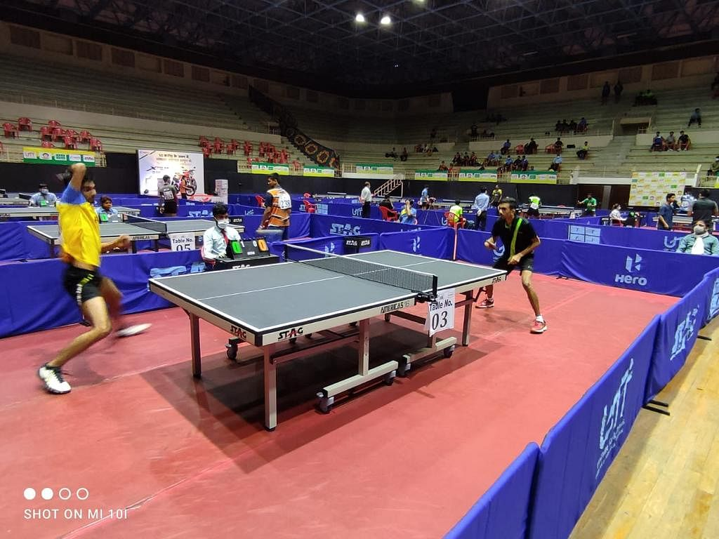 A table tennis match during championship