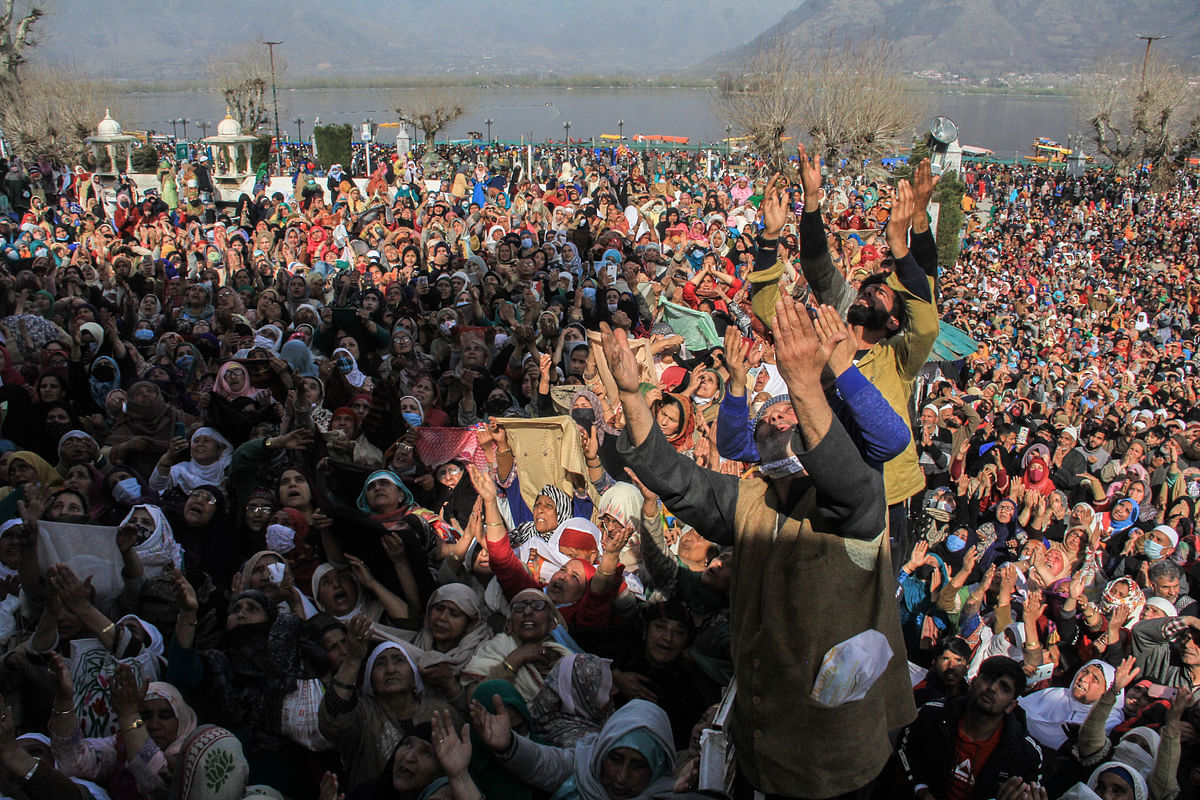 Kashmiri Muslims react upon seeing a relic believed to be a hair from the beard of Prophet Mohammed, being displayed on Friday following Meeraj-un-Nabi, a festival which marks the ascension of Prophet Mohammed to Heaven, at the Hazratbal shrine in Srinagar.