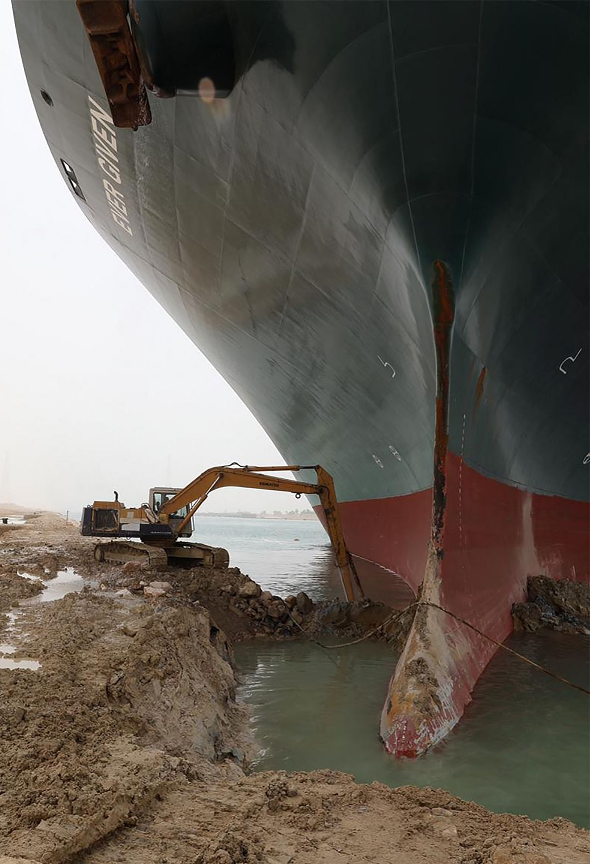 A handout picture released by the Suez Canal Authority on March 25, 2021 shows the Taiwan-owned MV Ever Given lodged sideways and impeding all traffic across the waterway