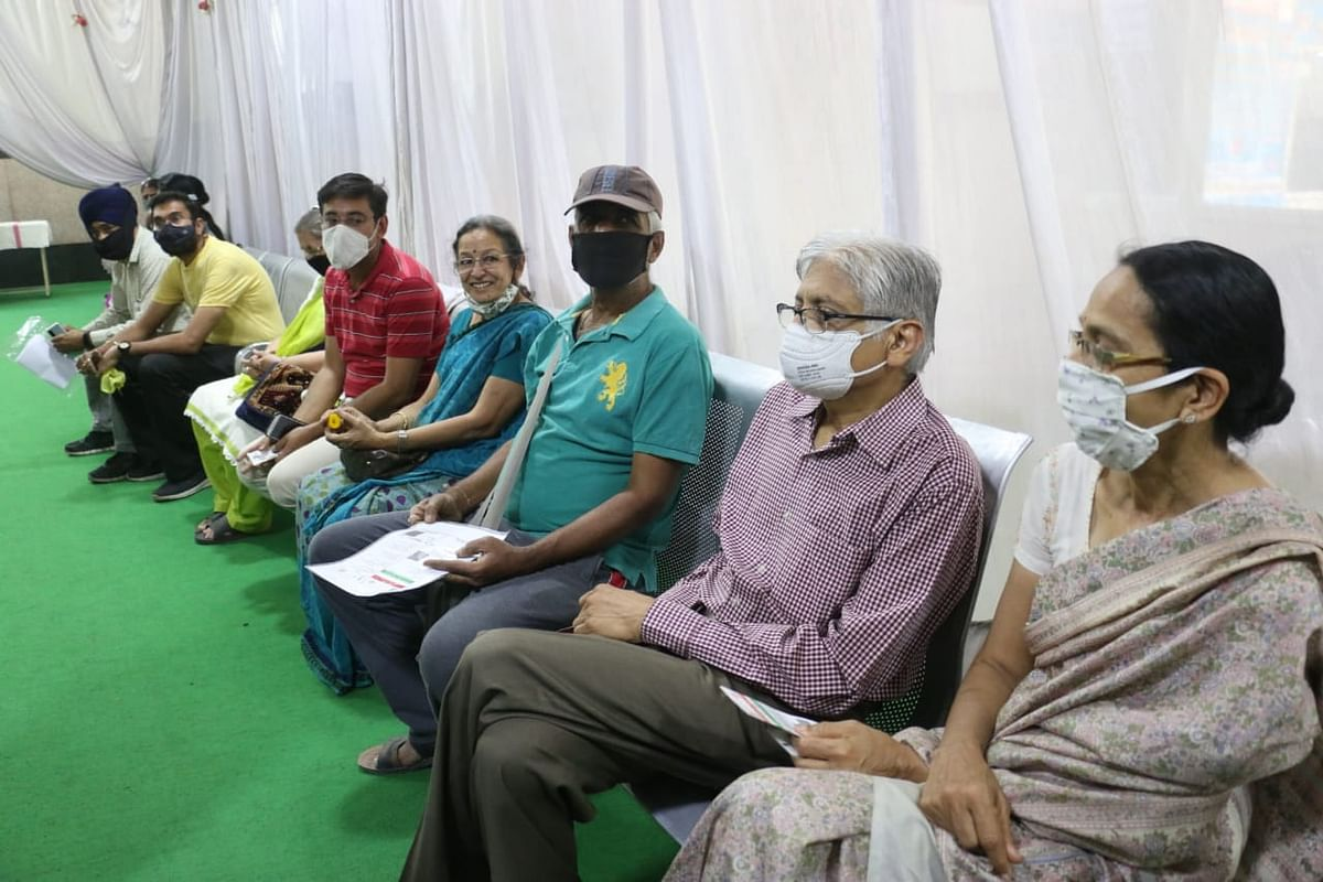 Senior citizens await their turn for inoculation at PC Sethi Hospital in Indore on Monday