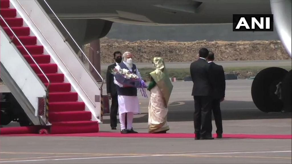 Prime Minister of Bangladesh, Sheikh Hasina receives PM Narendra Modi. Visuals from Hazrat Shahjalal International Airport in Dhaka.