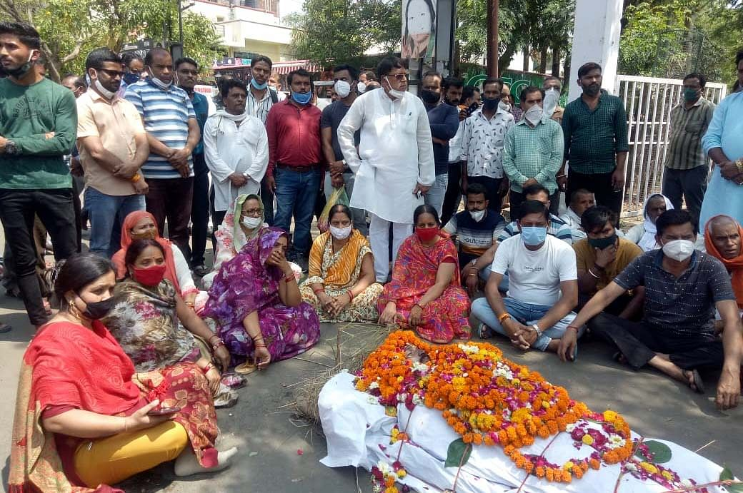 Family members of Home Guard stage dharna in front of Kamla Nagar police station on Wednesday.