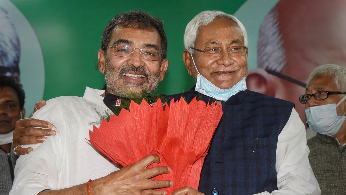 Patna: Bihar Chief Minister Nitish Kumar felicitates RLSP President Upendra Kushwaha after the party merged with JD(U), in Patna, Sunday, March. 14, 2021.