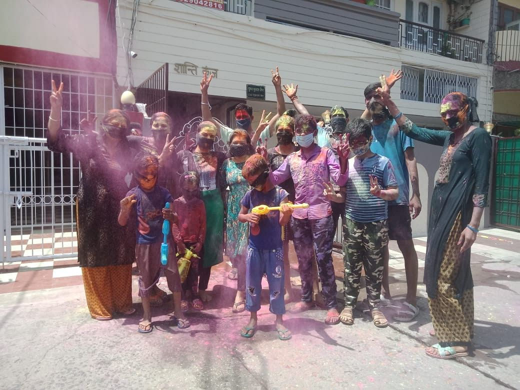 Family poses for Holi photo in New Market, Bhopal