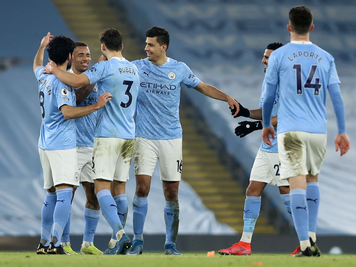 Gabriel Jesus celebrates with his team mates
