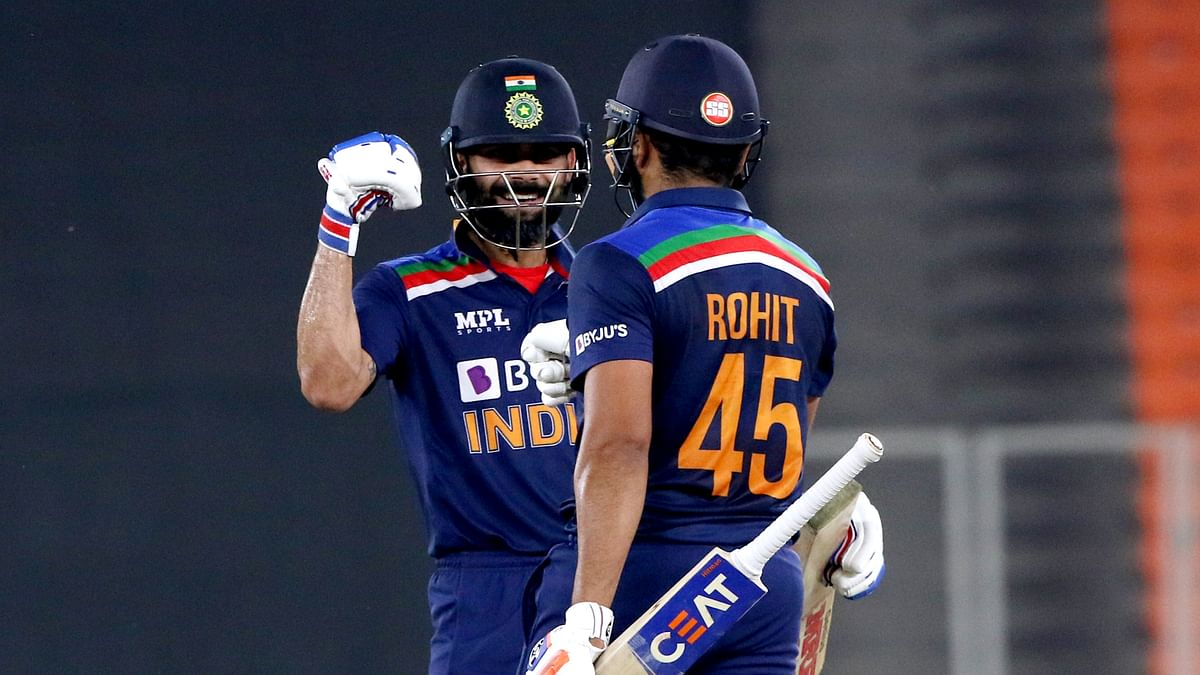 Indias Virat Kohli and Rohit Sharma celebrate their partnership during the 5th and final T20 match between India and England at Narendra Modi Stadium in Ahmedabad on Saturday.