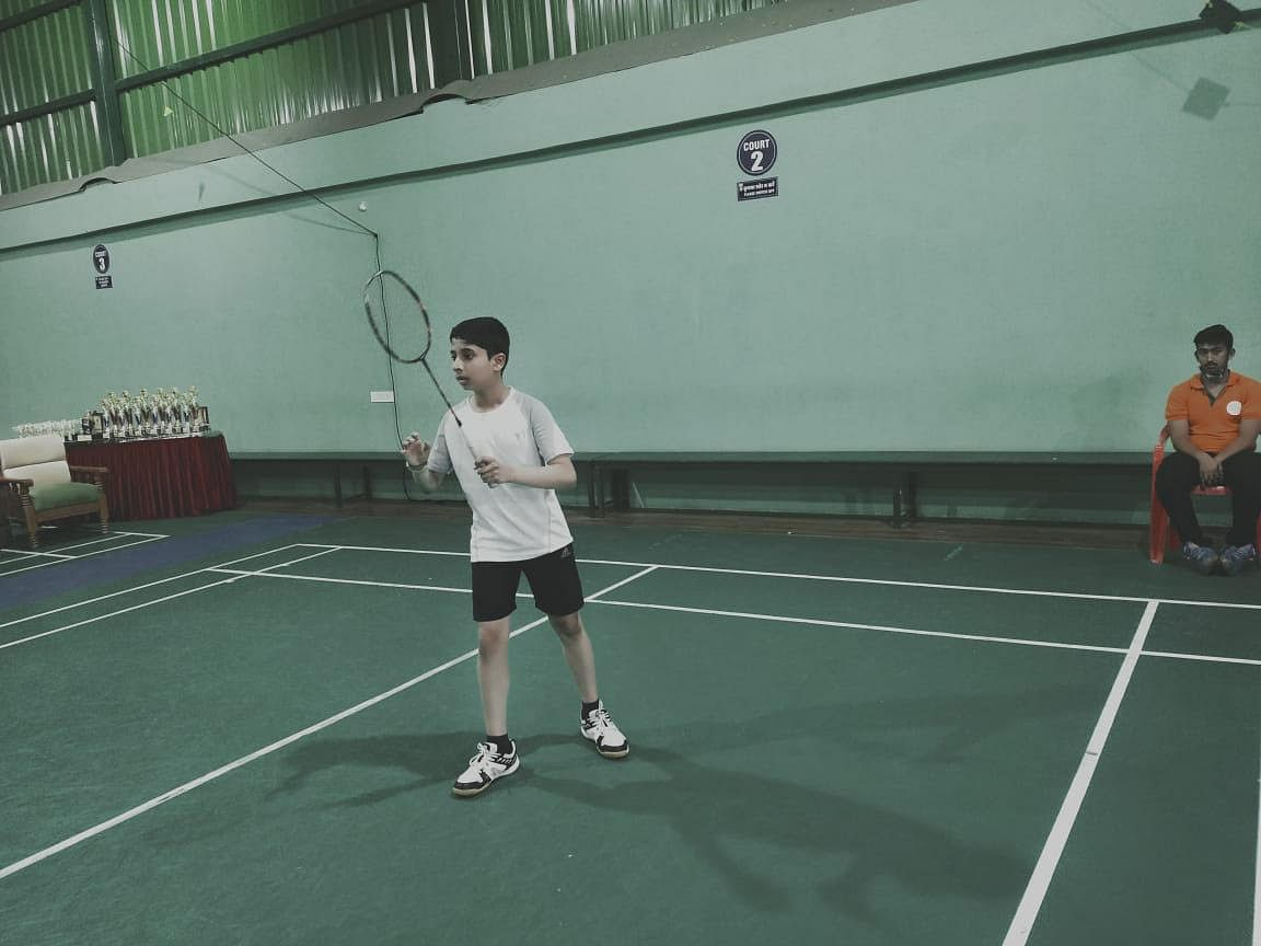 A player takes position during badminton match in Indore on Sunday