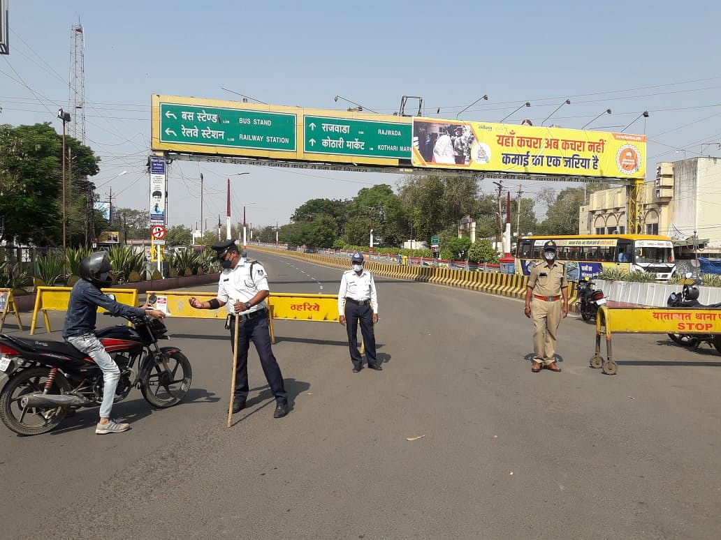 Policeman stopping a motorcycle rider near Regal Square in Indore on Sunday morning