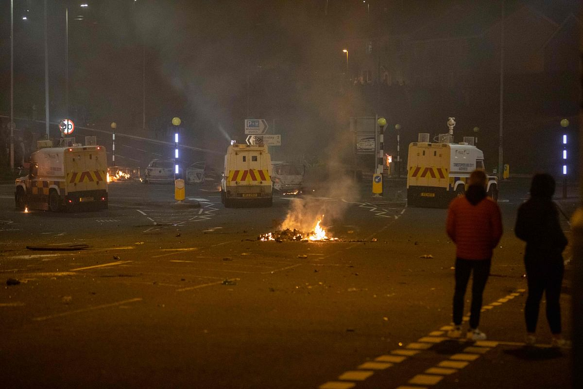 Police vehicles are positioned at the scene of violence in Newtownabbey, north of Belfast, in Northern Ireland on April 3, 2021.