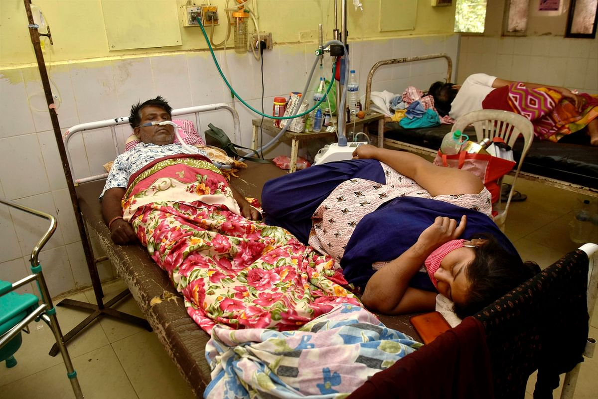 COVID-19 patients share a common bed at the casualty ward, as shortage of bed increased due to rising Covid-19 cases, at Rajendra Institute of Medical Sciences (RIMS) hospital, in Ranchi, Friday, April 16, 2021.